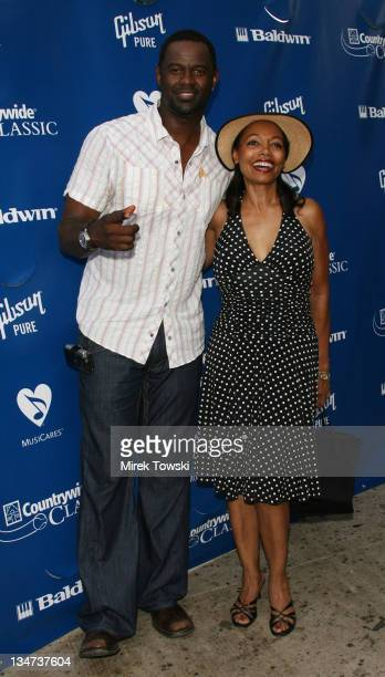 Brian McKnight and Florence LaRue during Gibson/Baldwin Night at the Net at Los Angeles Tennis Center in Los Angeles CA United States