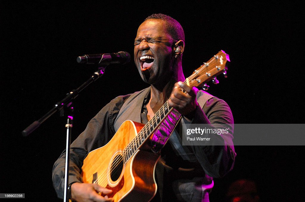 Brian McKnight plays guitar as he performs in concert at Masonic Temple Theater on November 23, 2012 in Detroit, United States.