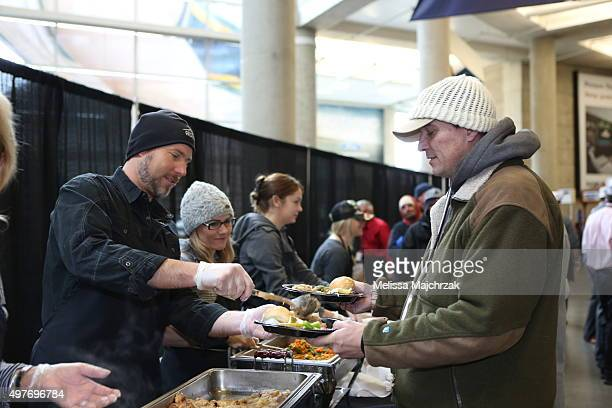 Brian Miller son of Larry H Miller of the Utah Jazz serves dinner during the 17th annual We Care We Share' Thanksgiving Dinner for local homeless and...
