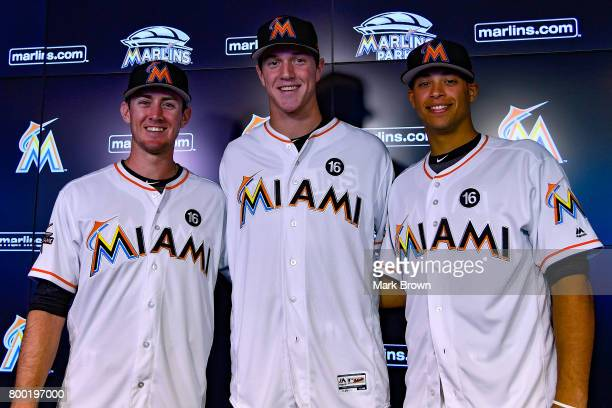 Brian Miller Trevor Rogers and Joe Dunand are introduced before the game between the Miami Marlins and the Chicago Cubs at Marlins Park on June 23...