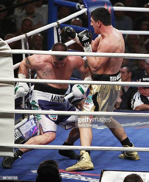 Brian Minto of the US falls to the ringfloor during his WBO World Championship Cruiserweight title fight against Marco Huck of Germany at the...