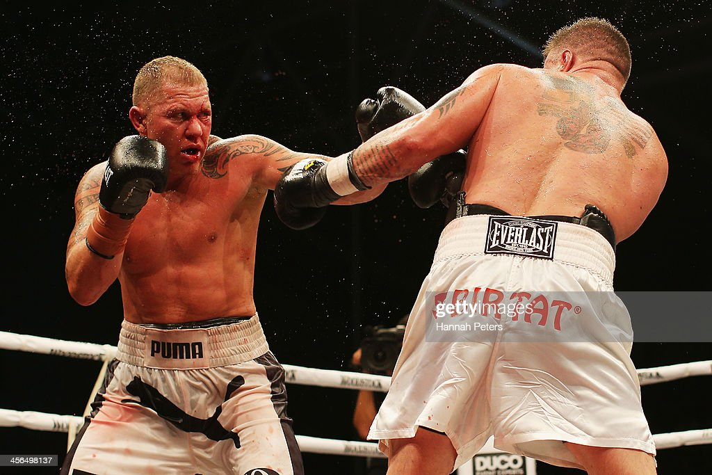 Brian Minto of the USA fights Shane Cameron of New Zealand during 'Fight for Life' at The Trusts Stadium on December 14 2013 in Auckland New Zealand