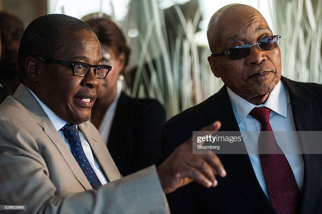 Brian Molefe, chief executive officer of Eskom Holdings SOC Ltd., left, shows Jacob Zuma, South Africa's president, around the headquarters of Eskom Holdings SOC Ltd. at Megawatt Park in Johannesburg, South Africa, on Friday, May 6, 2016. It appears to be just a matter of time before South Africas credit rating is cut to junk. Photographer: Waldo Swiegers/Bloomberg via Getty Images