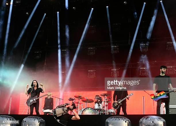 Brian Molko Matt Lunn and Stefan Olsdal of Placebo perform at Day 3 of Pinkpop Festival at Megaland on June 14 2015 in Landgraaf Netherlands