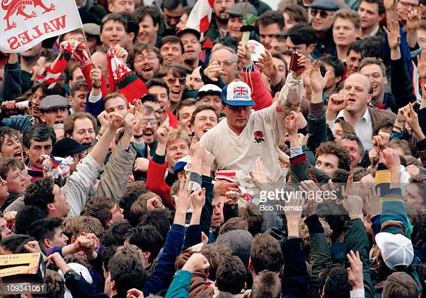 Brian Moore of England is lifted onto the shoulders of supporters following victory against Wales which completed the Grand Slam in the 5 Nations...