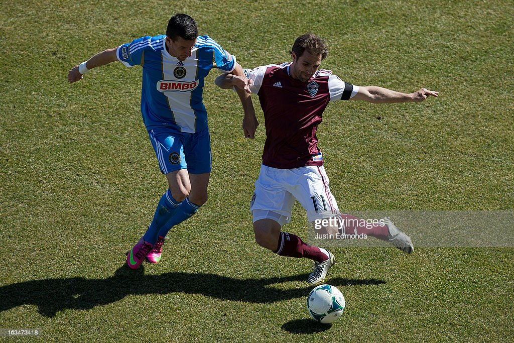 <a gi-track='captionPersonalityLinkClicked' href=/galleries/search?phrase=Brian+Mullan&family=editorial&specificpeople=241480 ng-click='$event.stopPropagation()'>Brian Mullan</a> #11 of the Colorado Rapids battles for the ball with Sebastien Le Toux #11 of the Philadelphia Union during the first half at Dick's Sporting Goods Park on March 10, 2013 in Commerce City, Colorado.