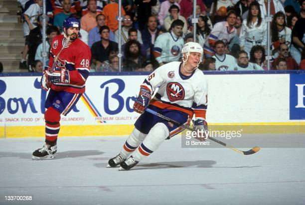 Brian Mullen of the New York Islanders and JJ Daigneault of the Montreal Canadiens skate on the ice during a 1993 Conference Finals game in May 1993...