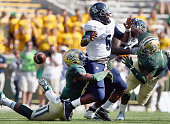 Brian Nance of the Baylor Bears sacks Driphus Jackson of the Rice Owls and forces a fumble in the second half at McLane Stadium on September 26 2015...