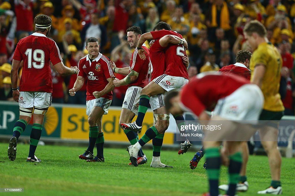 Brian O'Driscoll and Alex Cuthbert of the Lions celebrate victory during the First Test match between the Australian Wallabies and the British Irish...