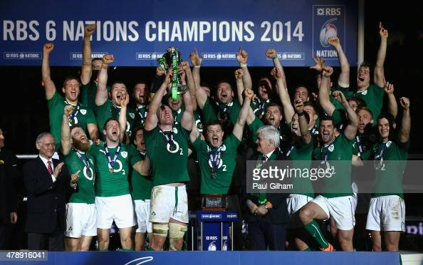Brian O'Driscoll and captain Paul O'Connell of Ireland celebrate with their teammates as they lift the trophy after winning the six nations...