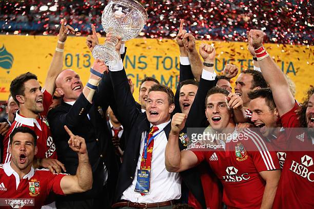 Brian O'Driscoll and Paul O'Connell of the Lions raise Tom Richards Cup after their victory during the International Test match between the...