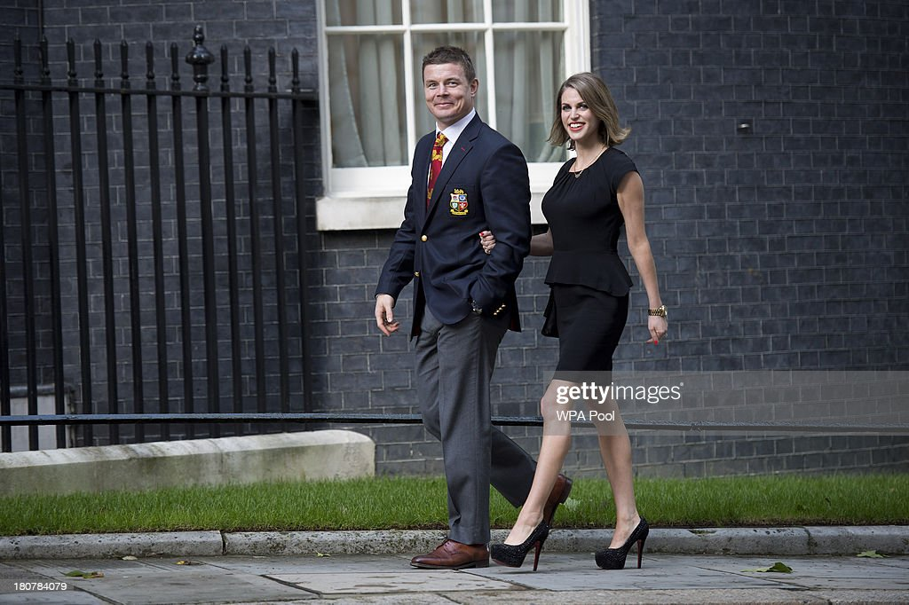 Brian O'Driscoll (L) and wife Amy Huberman attend an official reception at Downing Street on September 16, 2013 in London, England. The reception was to mark the British Lions victorious tour of Australia in the summer.