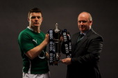 Brian O'Driscoll Captain and Declan Kidney of Ireland pose with the trophy during the RBS Six Nations Launch at The Hurlingham Club on January 26...