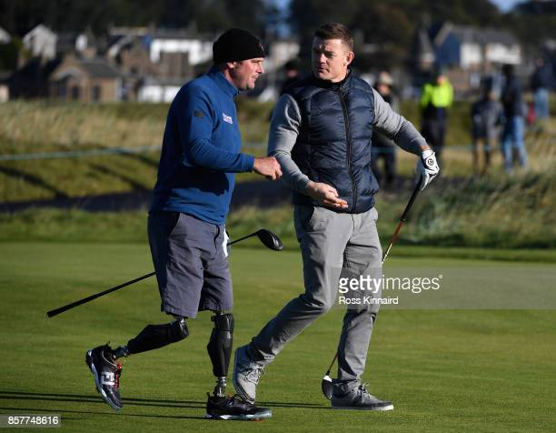Brian O'Driscoll former Rugby player and Ian Bishop walk onto the 2nd tee during day one of the 2017 Alfred Dunhill Championship at Carnoustie on...