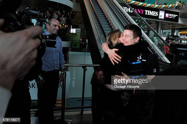 Brian O'Driscoll greets a relative as Ireland RBS Six Nations Rugby Championship winners 2014 arrive home at the Airport on March 16 2014 in Dublin...