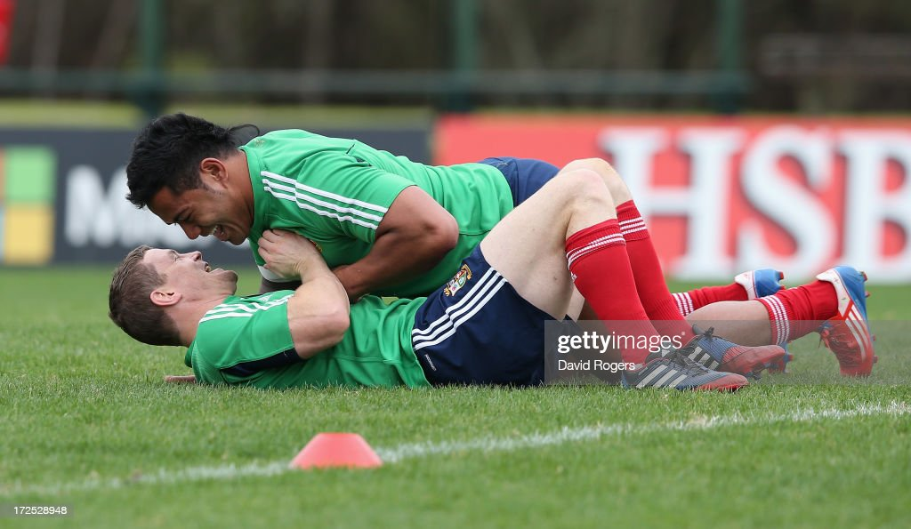 Brian O'Driscoll, looks dejected after being dropped by the Lions for the third and final test against the Wallabies wrestles with team mate Manu Tuilagi during a British & Irish Lions training session held at the Noosa Dolphins Rugby Club on July 3, 2013 in Noosa, Australia.
