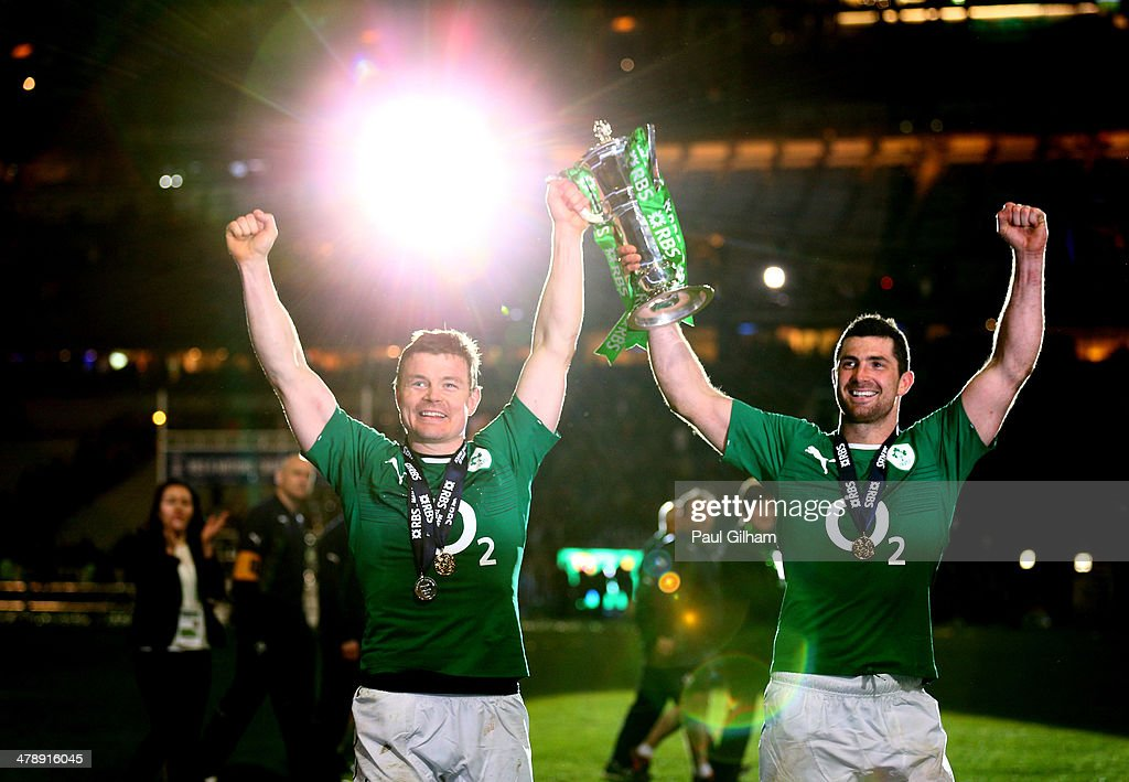 Brian O'Driscoll of Ireland and Dean Kearney of Ireland celebrate with the trophy after winning the six nations championship with a 22-20 victory over France during the RBS Six Nations match between France and Ireland at Stade de France on March 15, 2014 in Paris, France.