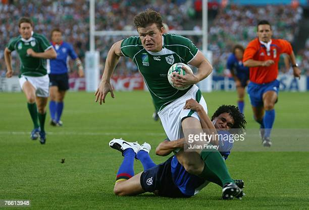 Brian O'Driscoll of Ireland goes over to score the opening try as he is tackled by Tertius Losper of Namibia during Match Eight of the Rugby World...