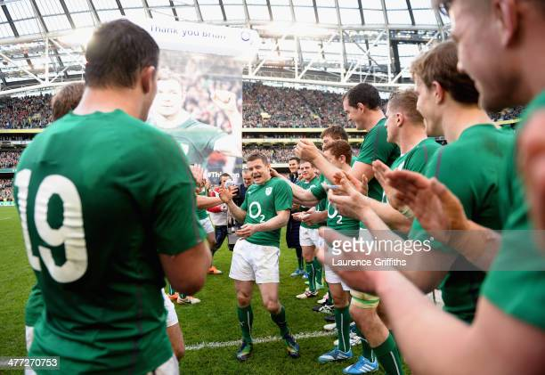 Brian O'Driscoll of Ireland is applauded off the field by his team mates after his last home appearance the RBS Six Nations match between Ireland and...