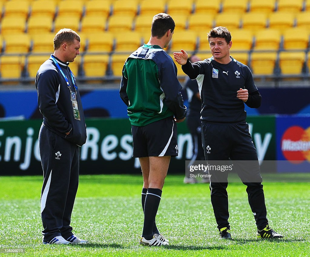 <a gi-track='captionPersonalityLinkClicked' href=/galleries/search?phrase=Brian+O%27Driscoll&family=editorial&specificpeople=194745 ng-click='$event.stopPropagation()'>Brian O'Driscoll</a> (R) of Ireland talks with teammates Jonathan Sexton (C) and <a gi-track='captionPersonalityLinkClicked' href=/galleries/search?phrase=Keith+Earls&family=editorial&specificpeople=5409008 ng-click='$event.stopPropagation()'>Keith Earls</a> during an Ireland IRB Rugby World Cup 2011 captain's run at Wellington Regional Stadium on October 7, 2011 in Wellington, New Zealand.