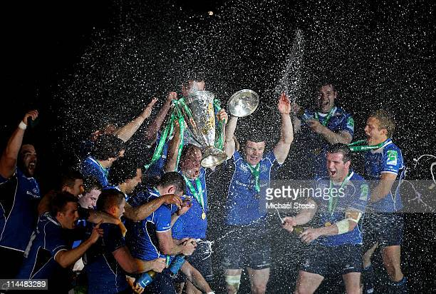 Brian O'Driscoll of Leinster and his team mates celebrate victory with the trophy and champagne at the end of the Heineken Cup Final match between...