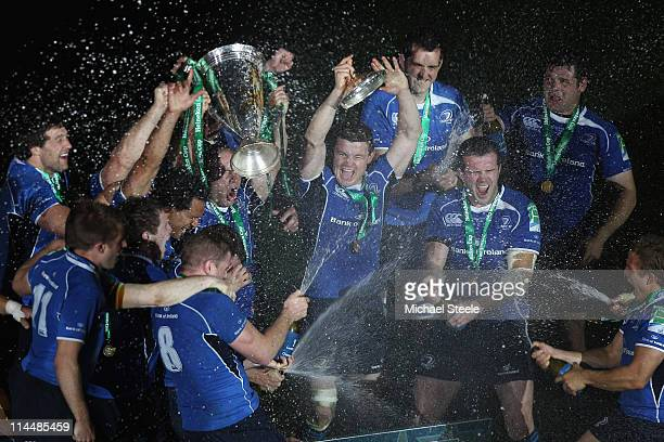 Brian O'Driscoll of Leinster leads the victory celebrations during the Heineken Cup Final match between Leinster and Northampton Saints at the...