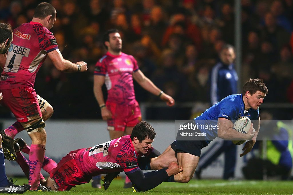 <a gi-track='captionPersonalityLinkClicked' href=/galleries/search?phrase=Brian+O%27Driscoll&family=editorial&specificpeople=194745 ng-click='$event.stopPropagation()'>Brian O'Driscoll</a> (R )of Leinster scores his sides third try as Ian Whitten (L) of Exeter Chiefs fails to tackle during the Heineken Cup Pool Five match between Exeter Chiefs and Leinster at Sandy Park on January 19, 2013 in Exeter, England.