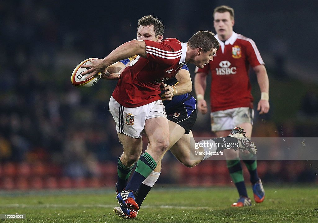 <a gi-track='captionPersonalityLinkClicked' href=/galleries/search?phrase=Brian+O%27Driscoll&family=editorial&specificpeople=194745 ng-click='$event.stopPropagation()'>Brian O'Driscoll</a> of the Lions attempts to catch the ball behind his back during the match between Combined Country and the British & Irish Lions at Hunter Stadium on June 11, 2013 in Newcastle, Australia.
