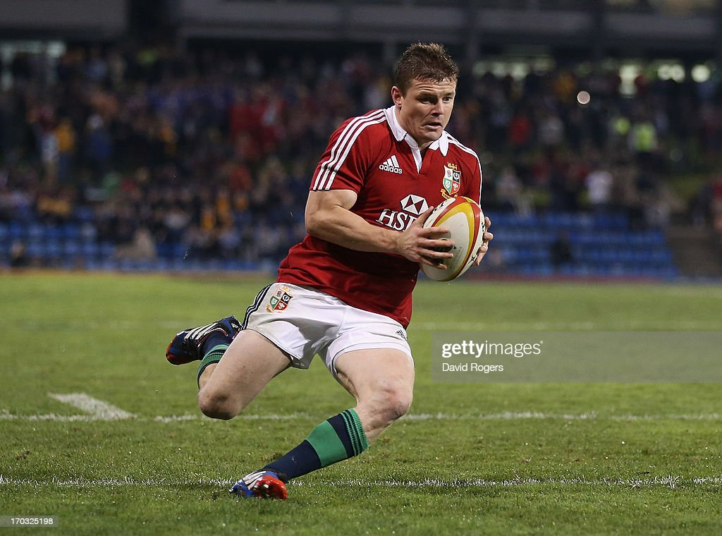 Brian O'Driscoll of the Lions dives over for a try during the match between Combined Country and the British & Irish Lions at Hunter Stadium on June 11, 2013 in Newcastle, Australia.