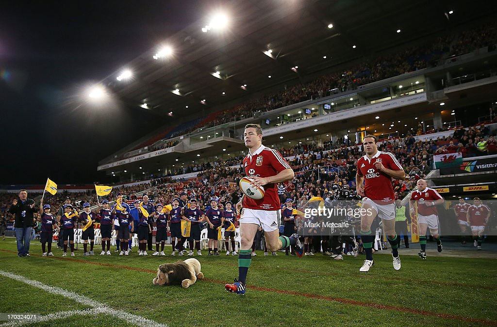 <a gi-track='captionPersonalityLinkClicked' href=/galleries/search?phrase=Brian+O%27Driscoll&family=editorial&specificpeople=194745 ng-click='$event.stopPropagation()'>Brian O'Driscoll</a> of the Lions leads the team onto the field during the match between Combined Country and the British & Irish Lions at Hunter Stadium on June 11, 2013 in Newcastle, Australia.