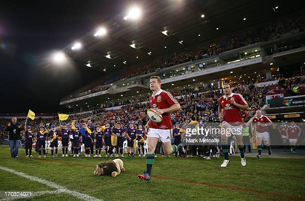 Brian O'Driscoll of the Lions leads the team onto the field during the match between Combined Country and the British Irish Lions at Hunter Stadium...