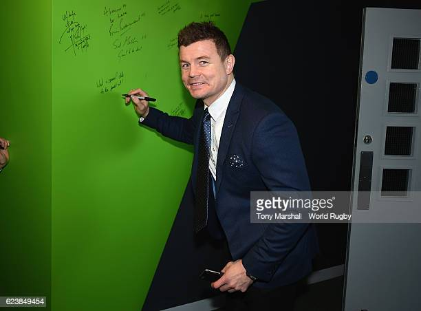 Brian O'Driscoll signs the wall in the World Rugby Hall of Fame Exhibition during the World Rugby Hall of Fame Launch at the World Rugby Hall of Fame...