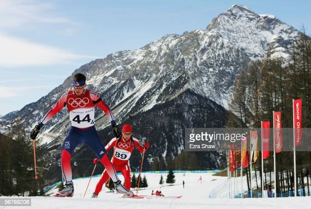 Brian Olsen of the United States and Michal Piecha of Poland practice on the Biathlon course prior to the Turin 2006 Winter Olympic Games on February...