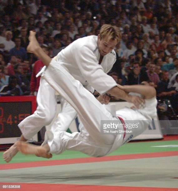 Brian Olson of the United States throws Hiroomi Fujita of Japan in the Mens 86kg Repechage fourth round during the World Judo Championships at Bercy...