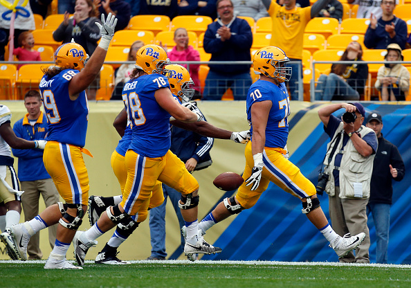 Brian O'Neill of the Pittsburgh Panthers rushes for a 24yard touchdown in the first half during the game against the Georgia Tech Yellow Jackets on...