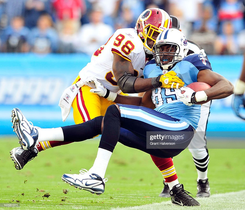 Brian Orakpo #98 of the Washington Redskins forces Jared Cook #89 of the Tennessee Titans out-of-bounds at LP Field on November 21, 2010 in Nashville, Tennessee. The Redskins won 19-16 in overtime.