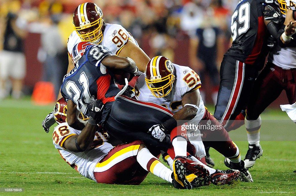 Brian Orakpo Rocky McIntosh and Ma'ake Kemoeatu of the Washington Redskins tackle CJ Spiller of the Buffalo Bills during the preseason game at FedEx...