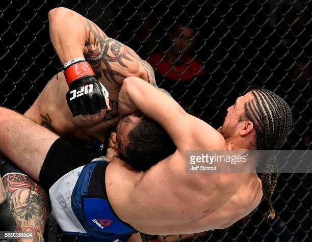 Brian Ortega attempts to submit Cub Swanson in their featherweight bout during the UFC Fight Night event inside Save Mart Center on December 9 2017...