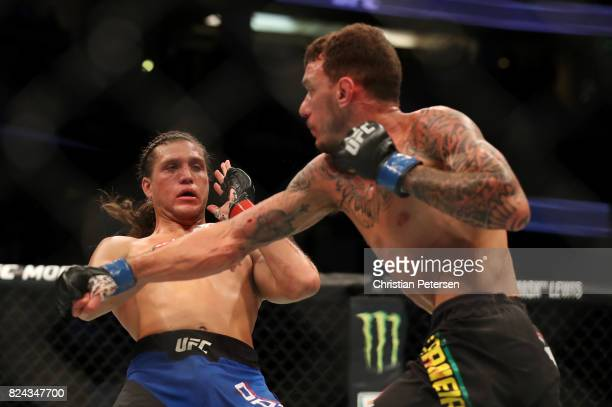 Brian Ortega avoids a punch from Renato Moicano of Brazil in their featherweight bout during the UFC 214 event at Honda Center on July 29 2017 in...