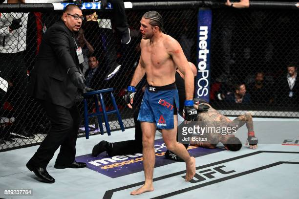 Brian Ortega celebrates his submission victory over Cub Swanson in their featherweight bout during the UFC Fight Night event inside Save Mart Center...