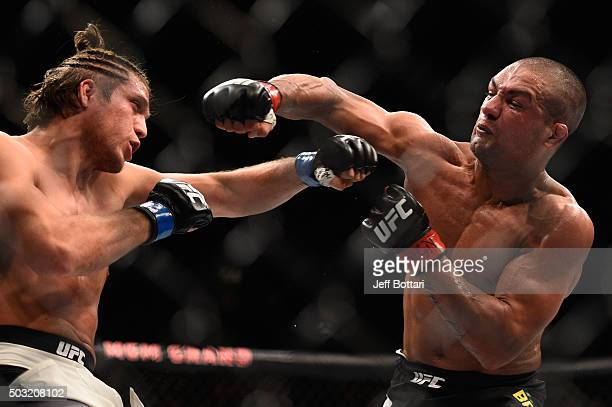 Brian Ortega punches Diego Brandao of Brazil in their featherweight bout during the UFC 195 event inside MGM Grand Garden Arena on January 2 2016 in...