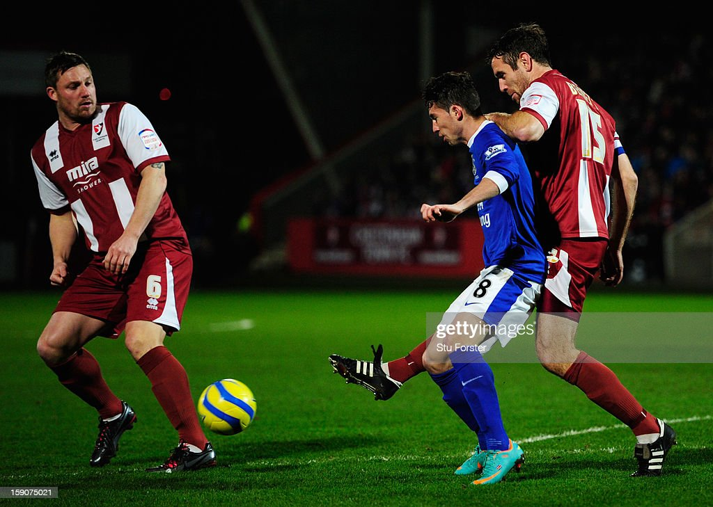 Brian Oviedo of Everton is foiled by Steve Elliott (L) and Alan Bennett of Cheltenham Town (R) during the FA Cup with Budweiser Third Round match between Cheltenham Town and Everton at Abbey Business Stadium on January 7, 2013 in Cheltenham, England.