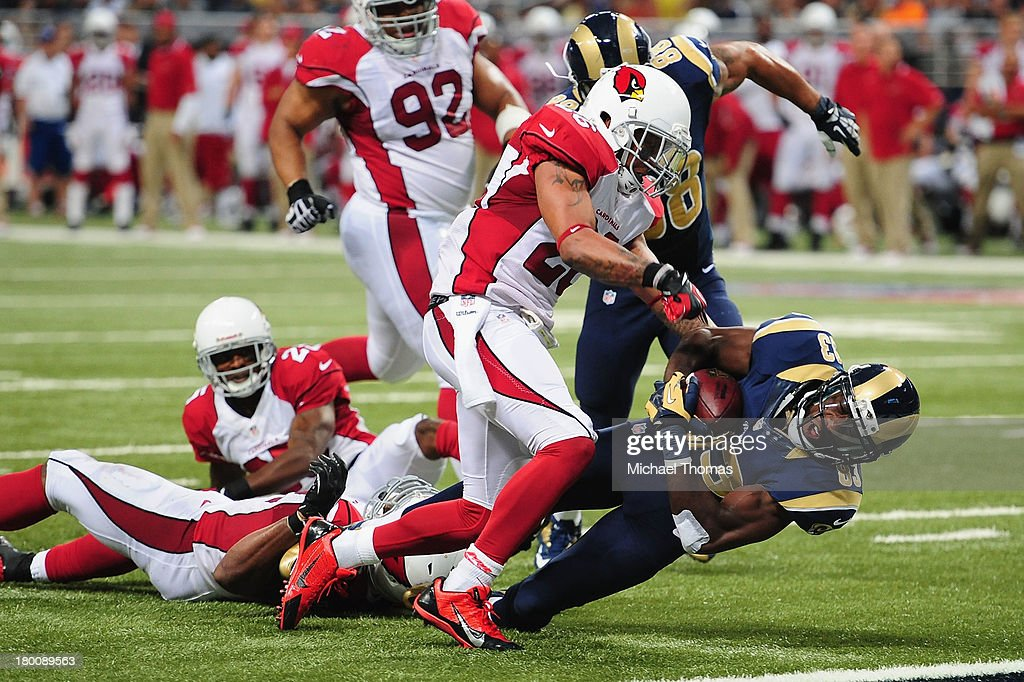 Brian Quick #83 of the St. Louis Rams is tackled against the Arizona Cardinals at the Edward Jones Dome on September 8, 2013 in St. Louis, Missouri.
