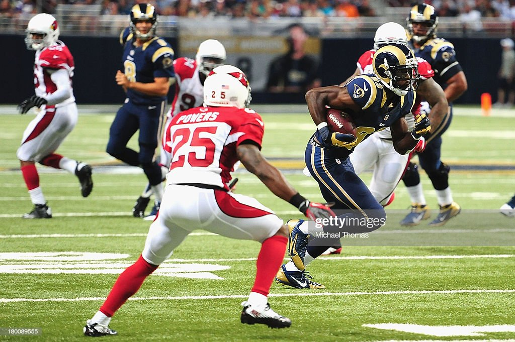 Brian Quick #83 of the St. Louis Rams makes a catch against the Arizona Cardinals at the Edward Jones Dome on September 8, 2013 in St. Louis, Missouri.