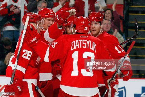 Brian Rafalski Nicklas Lidstrom Henrik Zetterberg Pavel Datsyuk and Dan Cleary of the Detroit Red Wings celebrate a goal during the game against the...