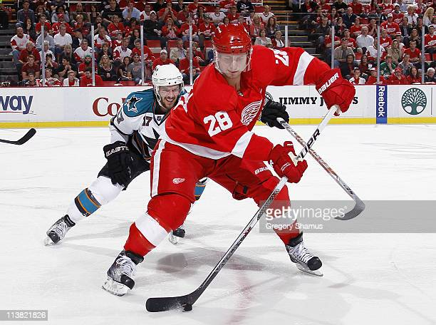 Brian Rafalski of the Detroit Red Wings controls the puck in front of Torrey Mitchell of the San Jose Sharks during the third period in Game Four of...