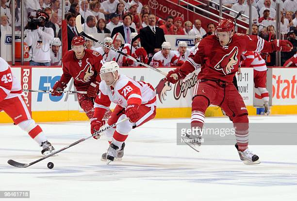 Brian Rafalski of the Detroit Red Wings steals the puck from Matthew Lombardi of the Phoenix Coyotes in Game One of the Western Conference...