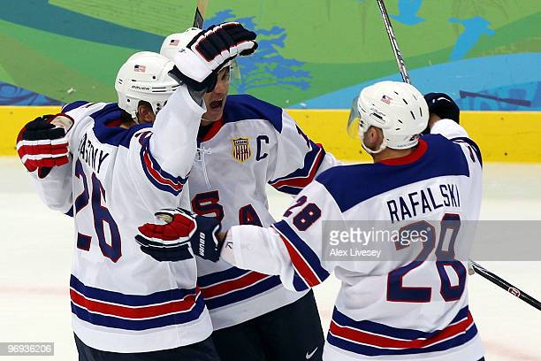 Brian Rafalski of the United States celebrates with his team mates after he scored the first goal during the ice hockey men's preliminary game...