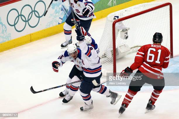 Brian Rafalski of the United States celebrates with his team mates after he scored during the ice hockey men's preliminary game between Canada and...