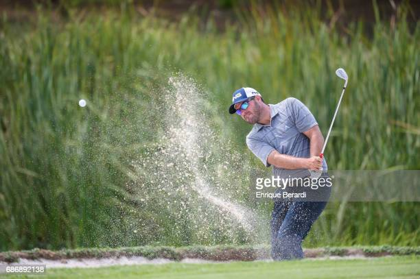 Brian Richey of the United States hits out of a bunker on the 17th hole during the weather shortened third and final round of the PGA TOUR...
